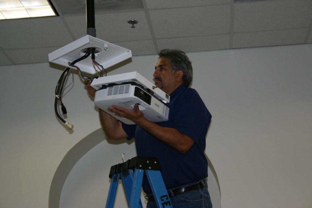 CETS staff installing new projectors