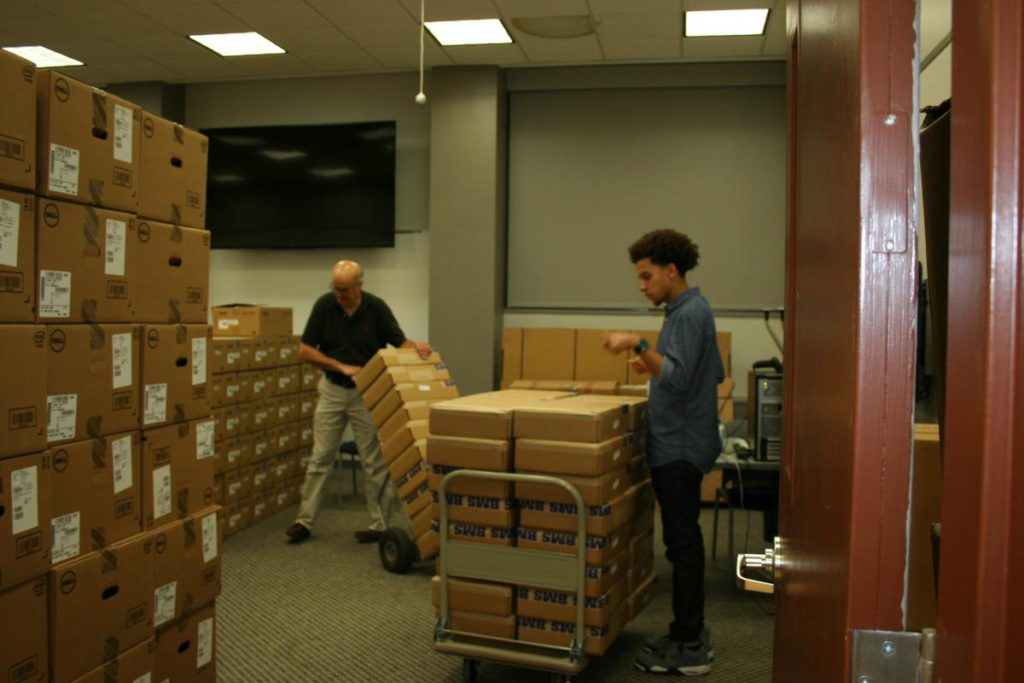 Workers receiving new inventory